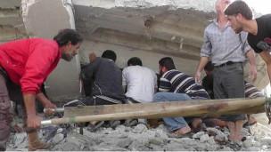 Nhà cửa bị tàn phá trong chiến sự ở Syria