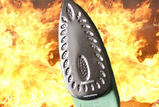 An iron with fire in the background