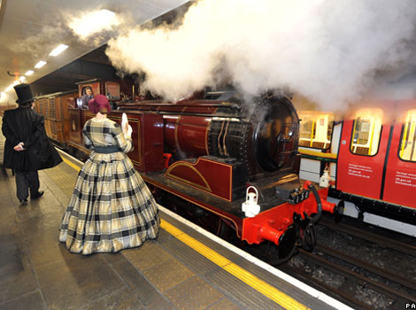 A steam train pulls into Moorgate station