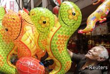 Man selling snake balloons
