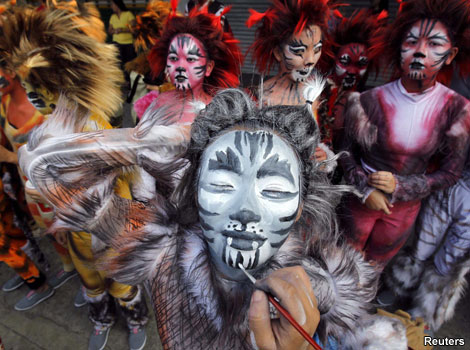 A student taking part in a parade for the Caracol festival in the Philippines