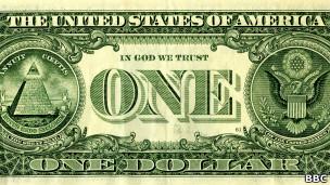 """Billete de un dólar estadounidense que muestra la frase """"En Dios confiamos"""""""