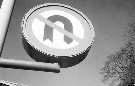 A u-turn sign