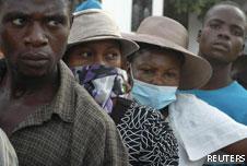 People in Haiti wait outside a hospital