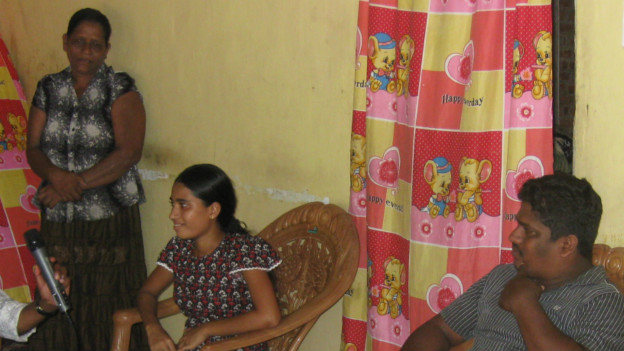 Nirmala with her husband and mother in law