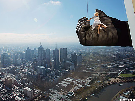Woman held by a 'King Kong hand' above Melbourne
