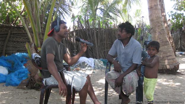 Fishermen leader Geeth Sumith with the BBC's Saroj Pathirana
