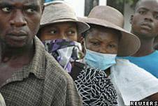 People wearing masks during cholera outbreak in Haiti