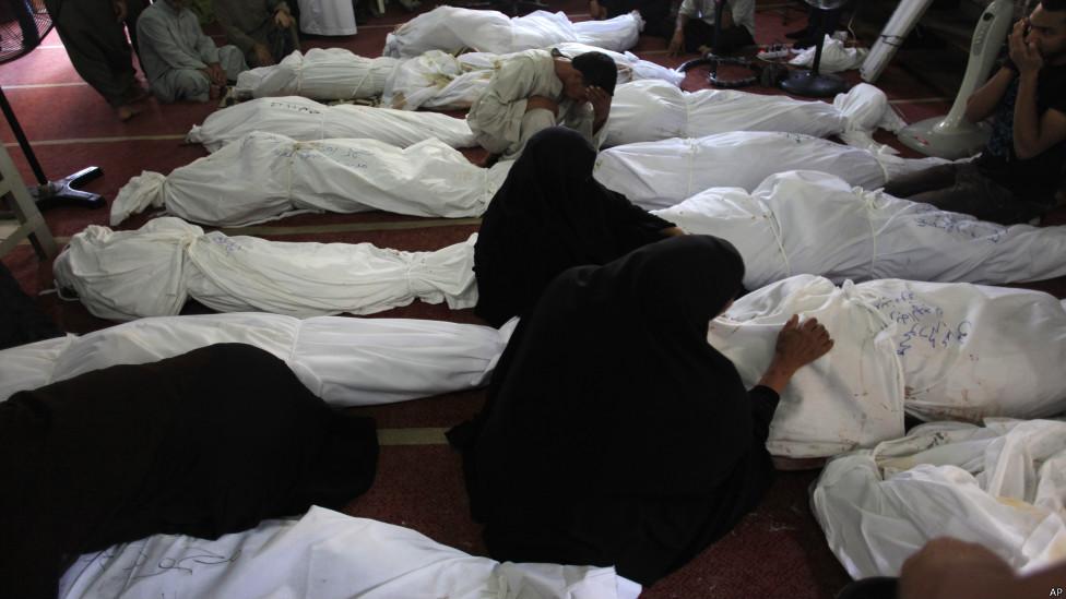 Jenasah korban protes, foto oleh Khalil Hamra/AP
