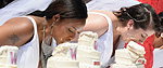 Brides in a cake eating competition