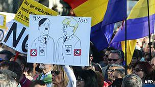 Manifestante en Madrid compara a Merkel con Hitler