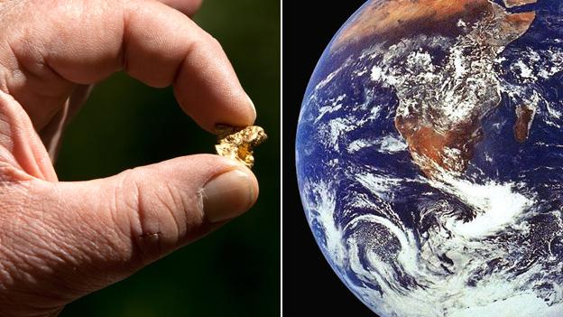 Pepita de oro e imagen de la Tierra