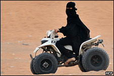 A Saudi woman drives a dune buggy