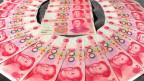 Yuan, moeda oficial da China | Crédito: AFP