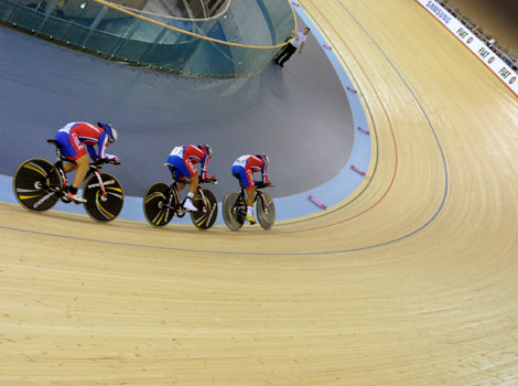 Cyclists take part in a race at the 2012 London Velodrome