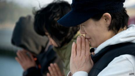 Parentes de vítimas do naufrágio na Coreia do Sul   Crédito: AFP