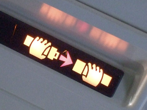 A 'fasten your seatbelt' sign on an aeroplane