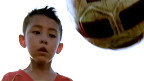 Niño futbolista chino