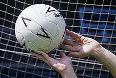 Goalkeeper catching a football