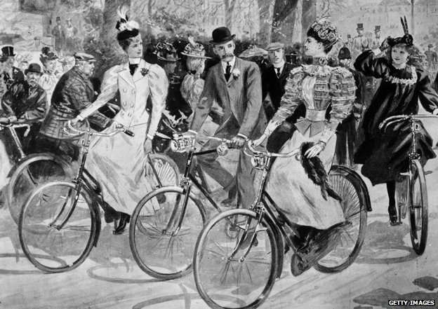 Pareja victoriana montando bicicleta