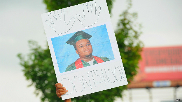 Cartel con una foto de Michael Brown