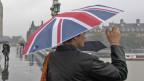 People in rain on Westminster Bridge