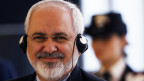 Iranian Foreign Minister Mohammad Javad Zarif smiles during a meeting with his Italian counterpart Federica Mogherini in Rome03/09/2014