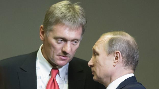 Дмитрий Песков (слева) и Владимир Путин